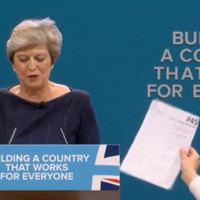 Comedian hands Theresa May a P45 during her Tory conference speech