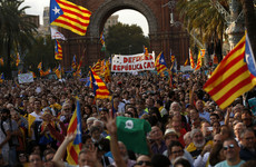 Catalonia asserts right to statehood but suspends declaration of independence for 'a few weeks'