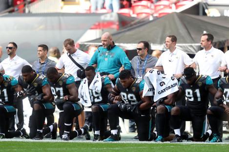 Jacksonville Jaguars players kneel in protest during the national anthem.