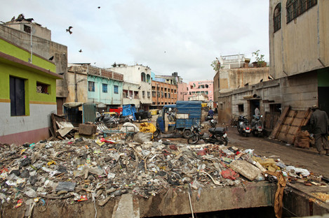 A street full of trash is pictured in Bangalore, India, in 2012.