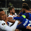 Everton bans supporter who appeared to strike a Lyon player while holding a child