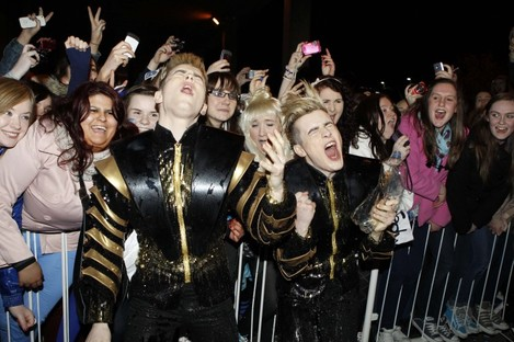 Jedward celebrate with their fans outside RTÉ studios in Donnybrook last night