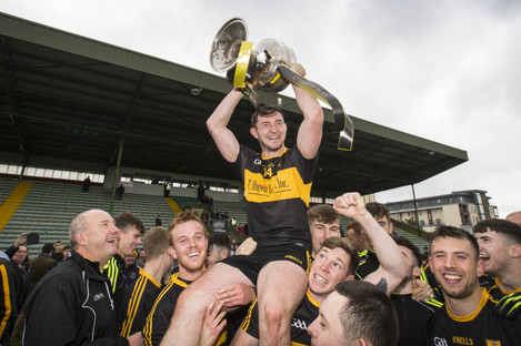 Dr Crokes' Dáithí Casey with the cup after the game.