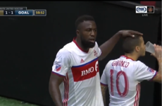 Giovinco takes a swig of beer launched from the crowd at Toronto FC team-mate Altidore