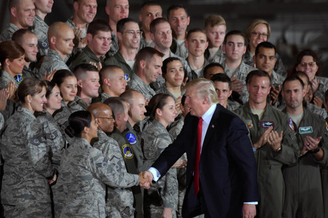 Trump shaking hands with soldiers in Maryland last month.