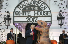 The photos of Donald Trump completely ignoring a kid dressed up as a dinosaur are just brilliant