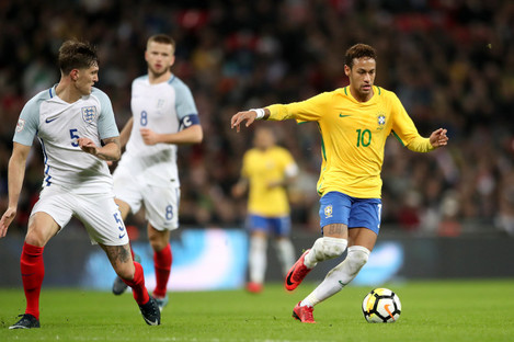 Neymar alongside John Stones at Wembley Stadium.