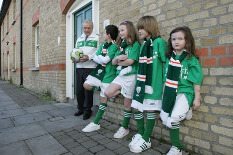 Soccer legend John Giles, who was revealed as the Grand Marshall of Dublin's St Patrick's Day Parade today, with Jamie Davis (10), Lucy Madden (8), Eric Davis (10) and Pia Madden (4)