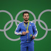 Iranian weightlifter auctions Olympic gold medal to help earthquake victims