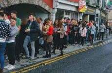 Here's why students are standing in massive queues outside Galway pubs today