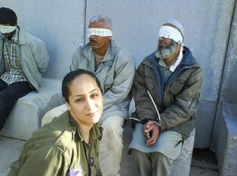 Ex-IDF soldier Eden Abergil posing with Palestinian prisoners.