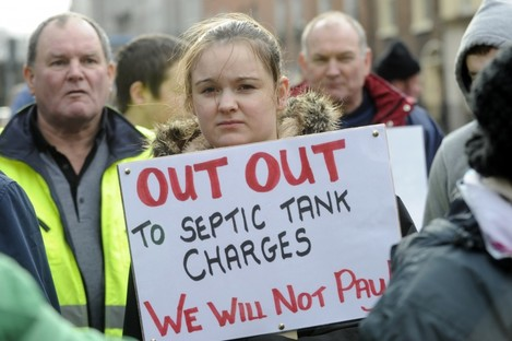 A protester in Galway who is against septic tank charges
