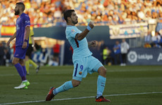 Luis Suarez hit a double to stretch Barca's La Liga lead