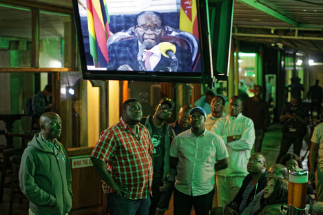 Disappointed Zimbabweans watch a televised address to the nation by President Robert Mugabe at a bar in downtown Harare.