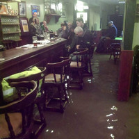 A pub in Co Laois flooded after heavy rain, but that didn't stop the regulars having a pint