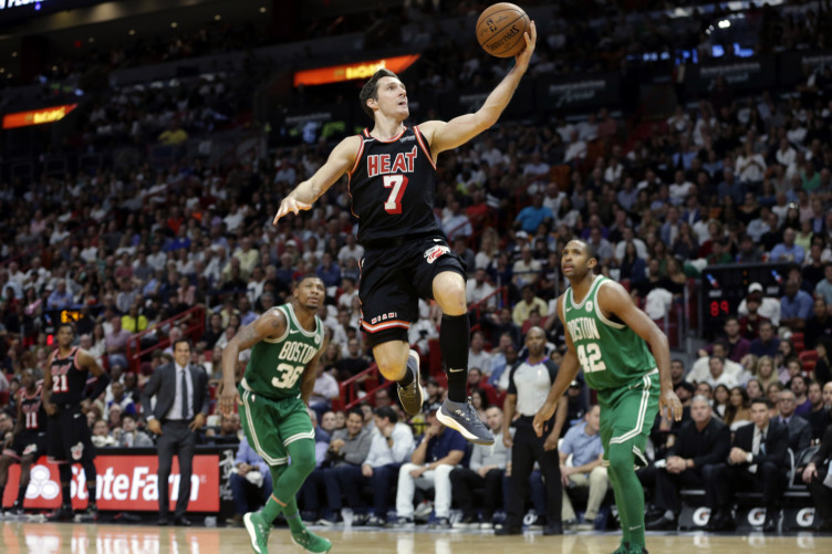 Goran Dragic (7) goes to the basket over the Celtics' Marcus Smart (36) and Al Horford (42).