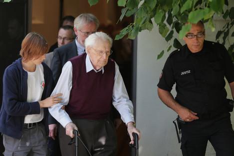 Former SS soldier Oskar Groening leaving court.