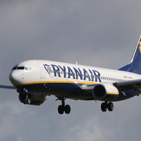 A law graduate scalded on a Ryanair flight has been awarded €10,000