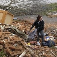 Toddler found alive in field after tornado dies