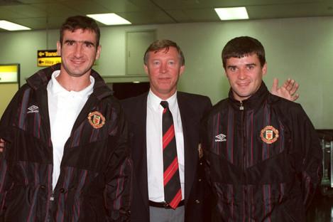 Eric Cantona (left) and Roy Keane (right) pose with Alex Ferguson.