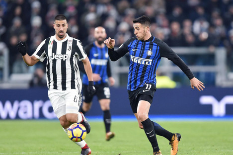 Inter's Matias Vecina is chased by Sami Khedira.