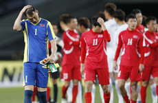 Late own goal decides tempestuous clash between North and South Korea