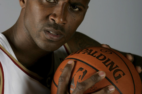 File photo of Lorenzen Wright posing at the NBA basketball team's media day in Independence, Ohio.