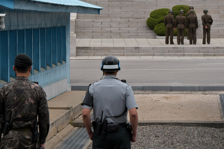 South Korean soldiers stand watching the North side at the joint security area (JSA) of Panmunjom in the demilitarised zone.