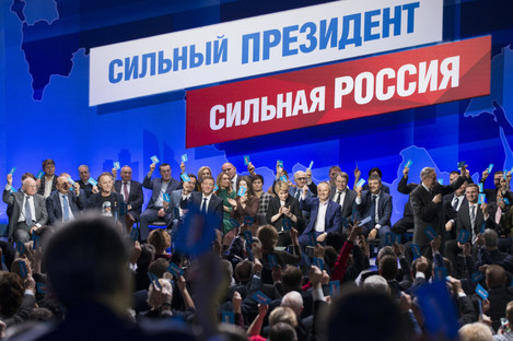 Supporters of incumbent Vladimir Putin vote to officially nominate him for presidency in Moscow, Russia