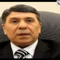 Syria's deputy minister for oil defects in YouTube video