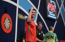 The fairytale continues! Ranked outsider books semi-final spot at World Darts Championship