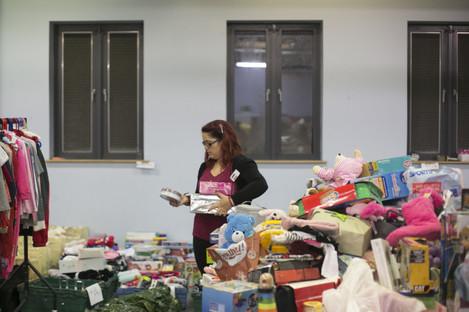 Volunteers sort out toys in Saint Vincent De Pauls Warehouse in Dublin