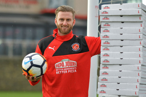 Neal pictured with his free pizzas before today's game.