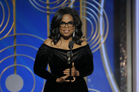 Oprah Winfrey accepts the Cecil B. Demille Award during the 75th Golden Globe Awards at the Beverly Hilton last night.