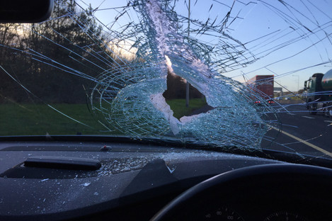 The hole left in Jason's windscreen following the incident.