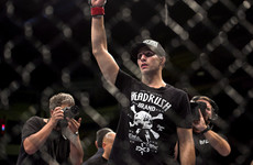 Rory MacDonald defies grim leg injury to be crowned Bellator champion