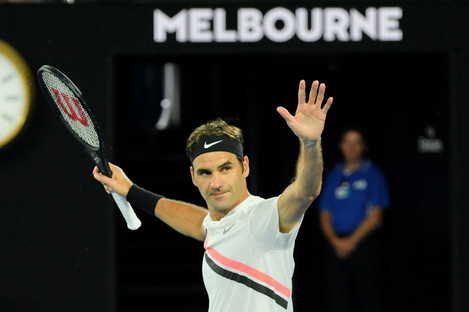 Federer celebrates his victory over Tomas Berdych.