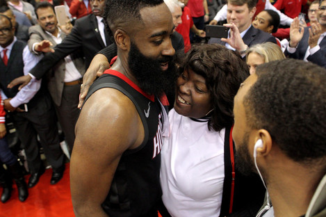 Harden is greeted by his mother, Monja Willis, after the game.