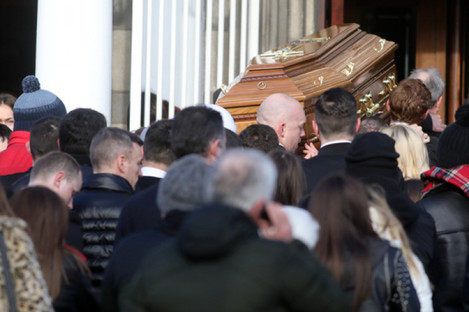 Family members and friends arriving with the coffin at Our Lady of Lourdes church on Sean McDermott Street for the funeral of gangland murder victim Derek Coakley Hutch.