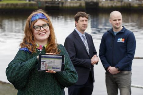Student Laoighseach Ní Choistealbha with Dr Brian McManus, Medical Director of VideoDoc, and Michael Kerrigan, USI President
