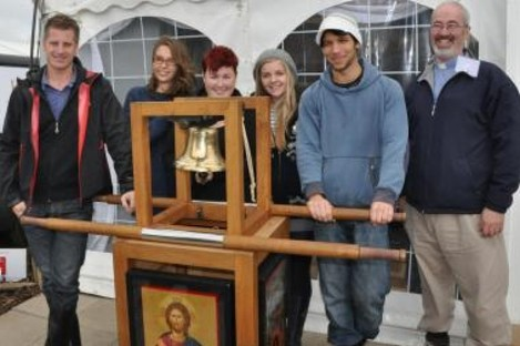 IEC volunteers with the Eucharistic Congress Bell, which will today be rung by Pope Benedict XVI inviting people to attend this year's congress in Dublin.