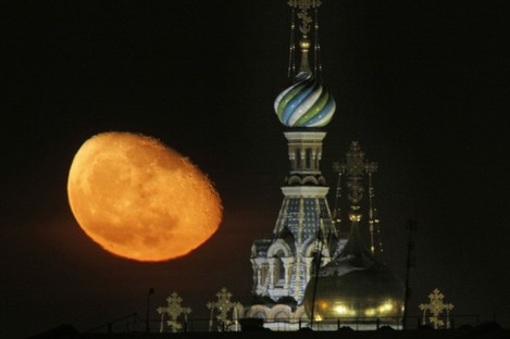 The moon rises above the Savior of Spilled Blood Cathedral in downtown St.Petersburg, Russia