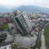 Pictures: Search for survivors in precariously-tilted buildings after Taiwan earthquake