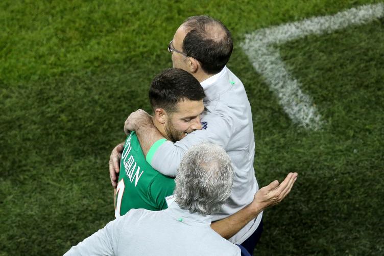 O'Neill and Hoolahan share a hug.