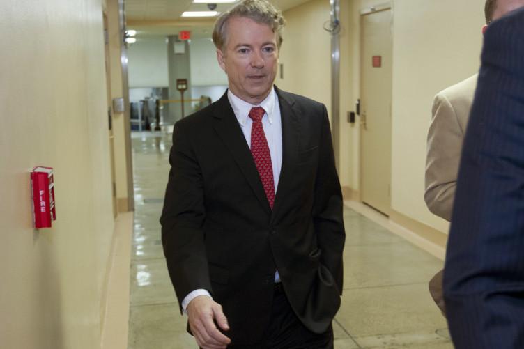 Senator Rand Paul walks to the senate chamber in the Capitol.
