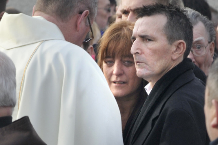 Mother Martina and Father Fran at the funeral mass of their son Warren O'Connor in the Church of St. Francis of Assisi, Clonshaugh Drive, Priorswood, Dublin.
