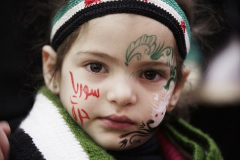 A Syrian girl attends a ceremony in Yemen to mark the anniversary of the uprising.