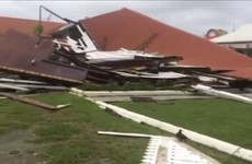 Powerful storm levels Tonga's parliament house and heads towards Fiji