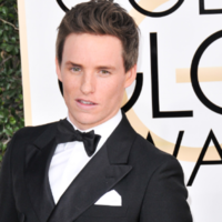 Eddie Redmayne says sharing a house with Jamie Dornan was like living with a puppy