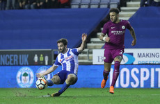 Paul Cook's Wigan dump Man City out of FA Cup after contentious Delph red